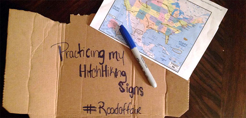 Practicing my Hitchhiking Signs