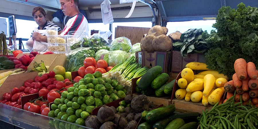 One of the vendors selling fresh produce