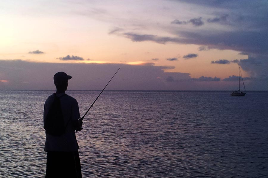 A local fishing at the pier in Caye Caulker, Belize