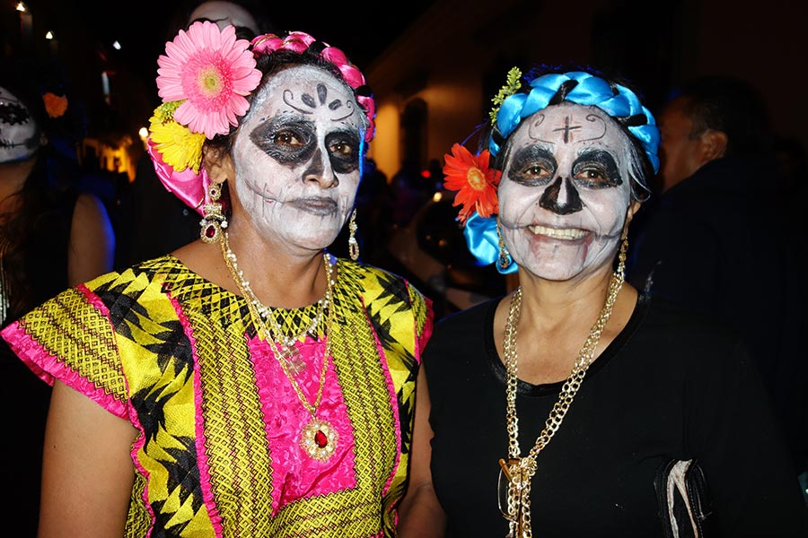 Old and young paint their faces for the day of the dead in Oaxaca