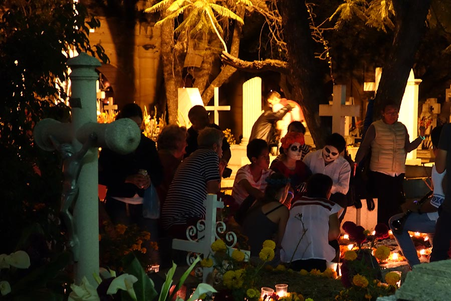 Mexican families mourning over their deceased at Pantelon de General Cemetery in Oaxaca