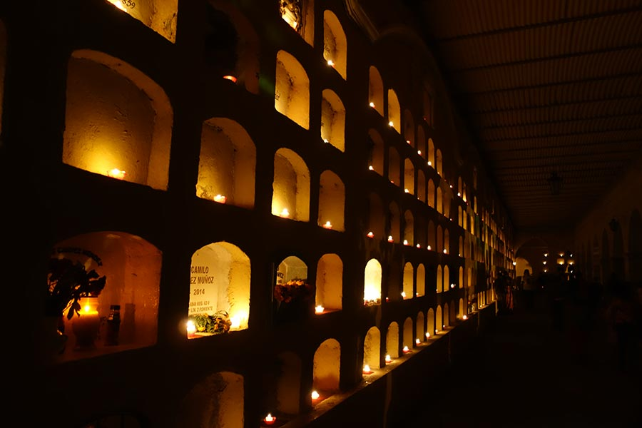 Lit up graves in Oaxaca during the day of the dead