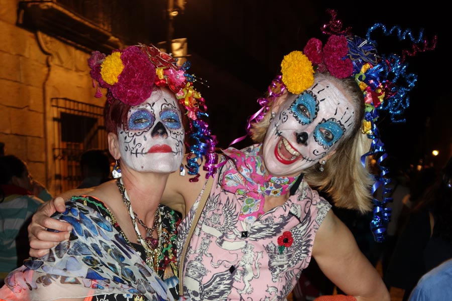 Two women with la catrina faces in oaxaca during the day of the dead