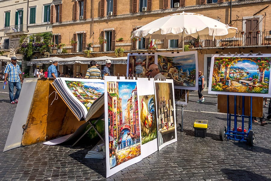 Man selling paintings in Rome Italy