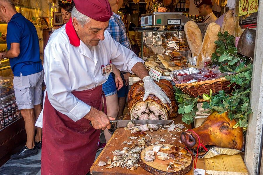 Man cutting Porchetta in Rome, Italy
