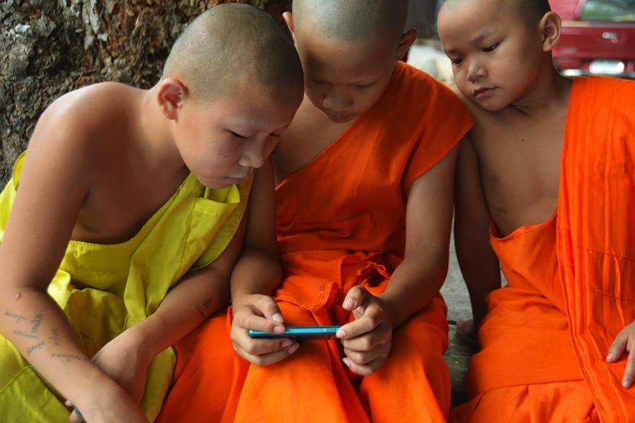 Novice monks on the phone