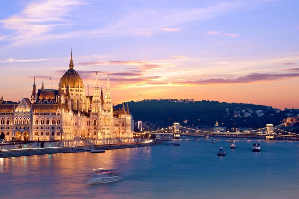 The picturesque landscape of the Parliament and the bridge over the Danube in Budapest at sunset