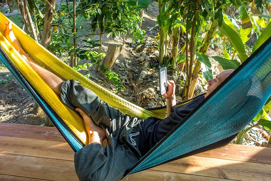 Ben reading in a Hammock in Pai Thailand