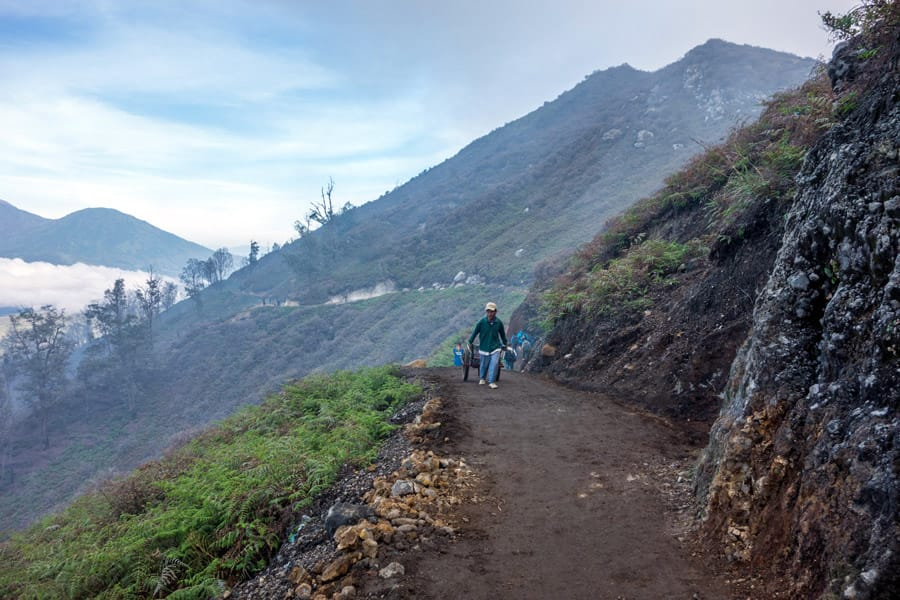 Miner carrying sulfur to the base camp of Mount Ijen