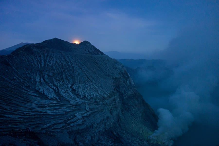 Moon shining over Mount Ijen