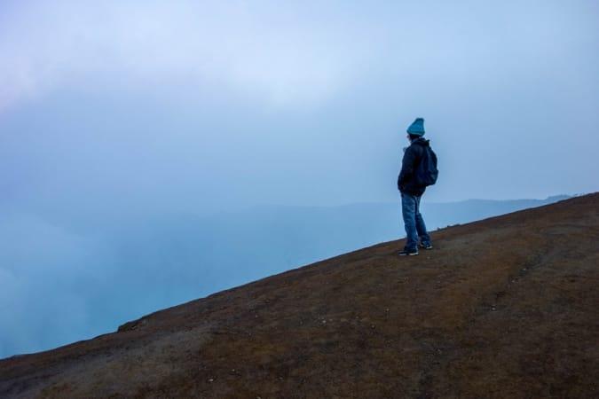 Ben starring into the smoke of Mount Ijen