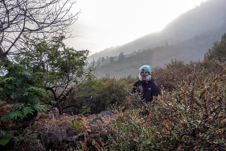 Ben with gas mask on top of Mount Ijen