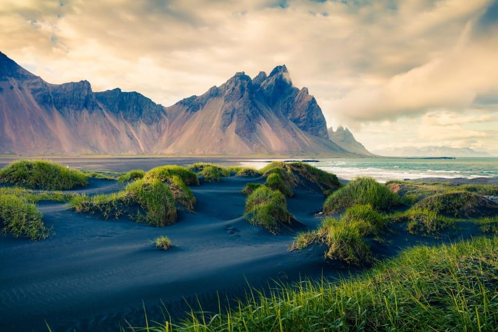Black sand dunes on the Stokksnes headland on southeastern Icelandic coast.