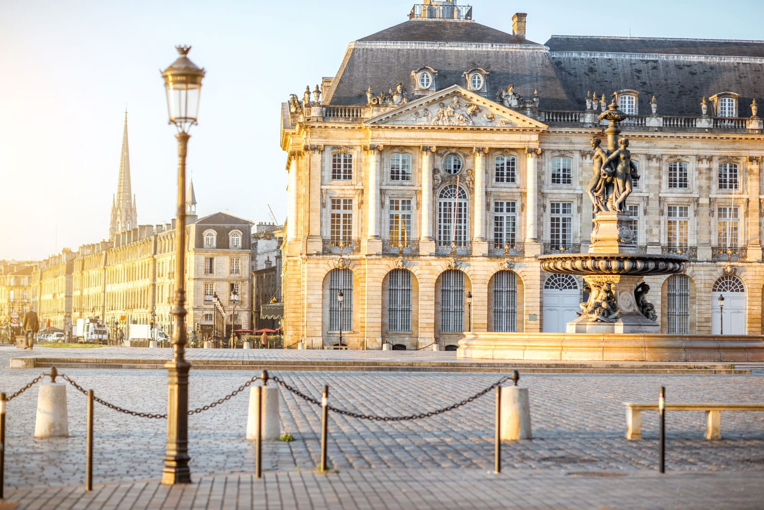 View on the famous La Bourse square with fountain during the morning in Bordeaux city, France