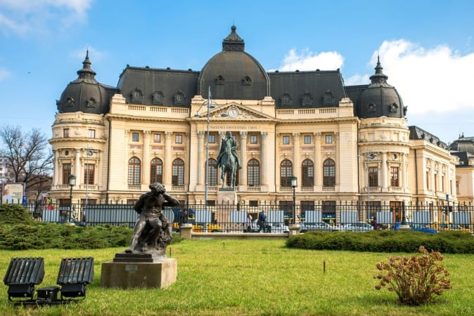 Central University Library of Bucharest with the Statue of King Carol
