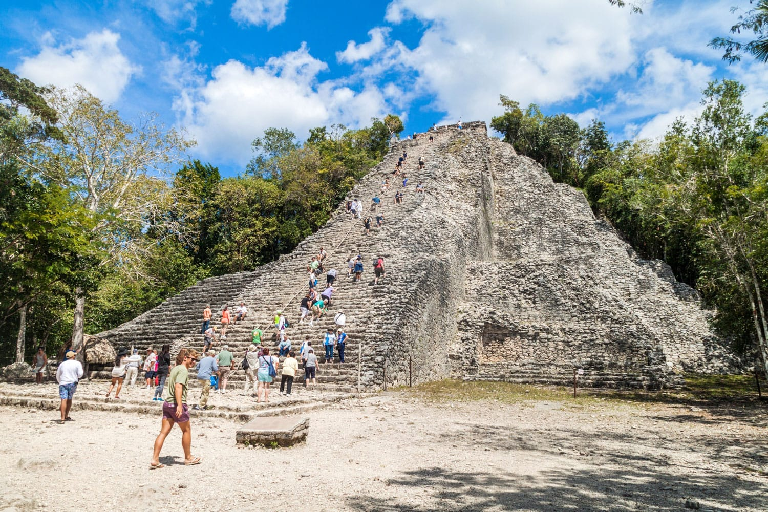 Tourist climb the Pyramid Nohoch Mul at the ruins of the Mayan city Coba, Mexico