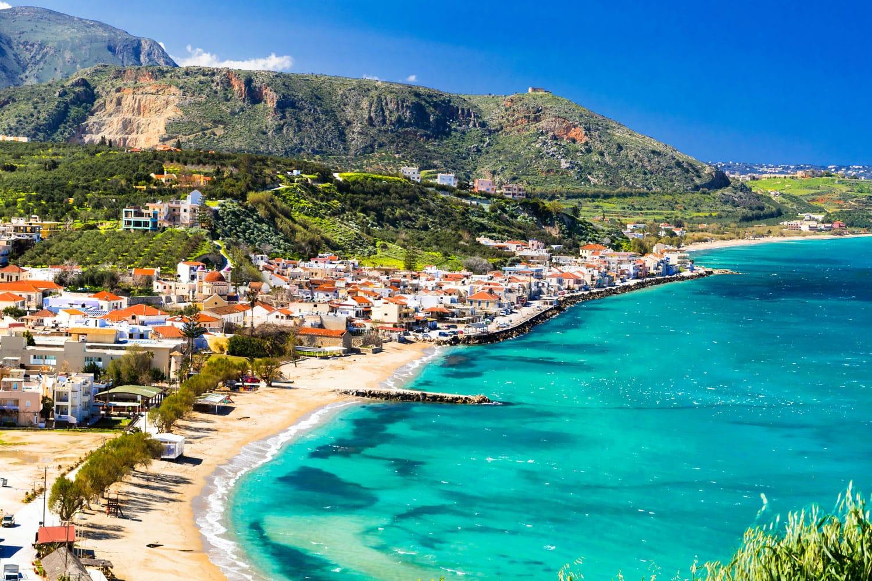 Beautiful Kalyves village on Crete Island with turquoise sea.