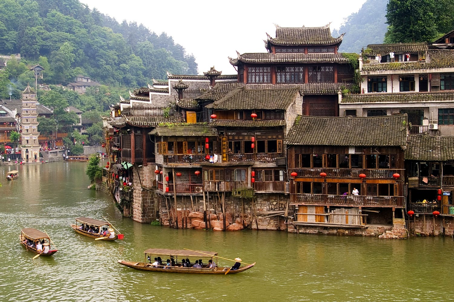 Boats and wooden houses at Phoenix Town - the one the four most attractive small towns in China, next to Tuojiang