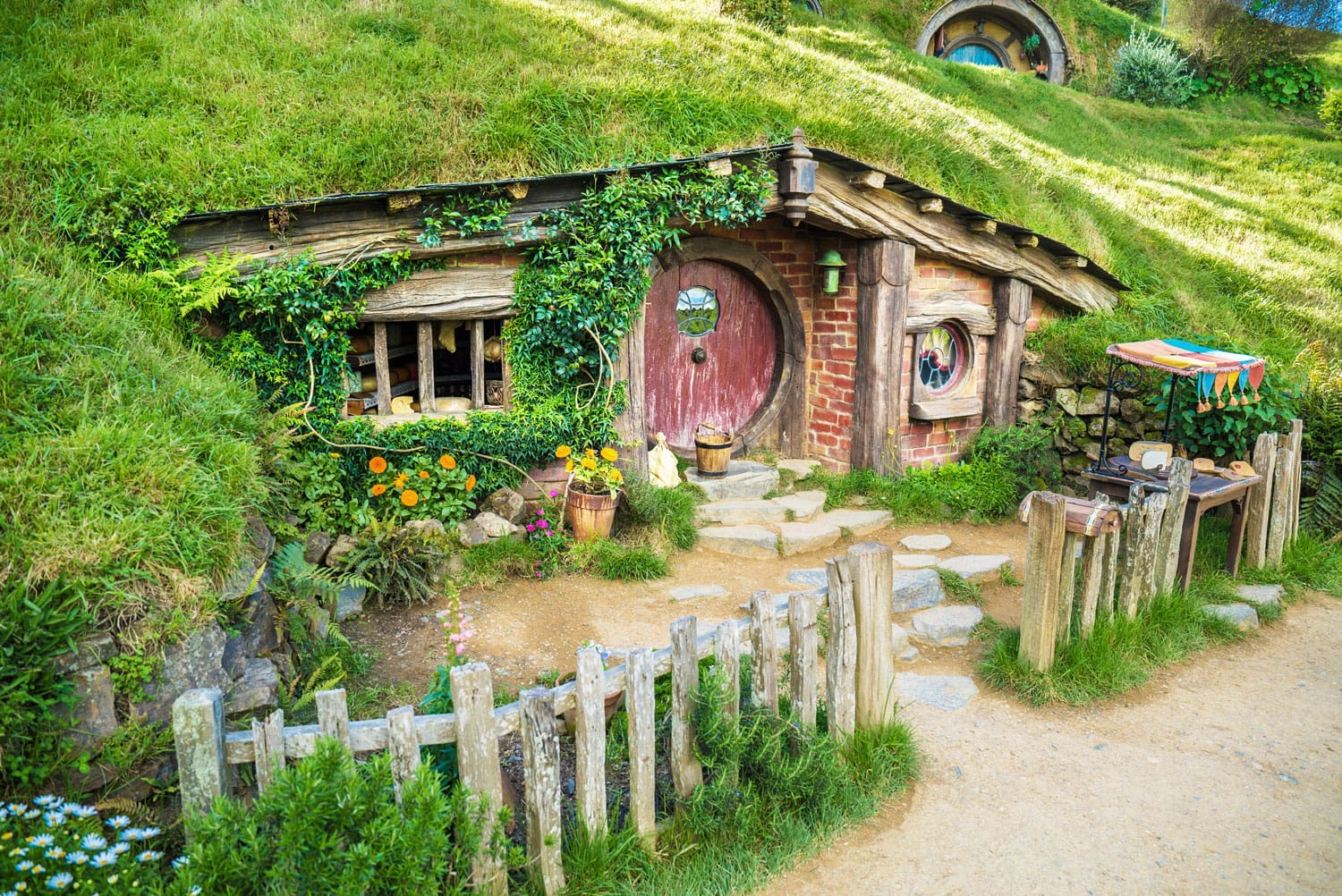 House with red door at Hobbiton Movie set New Zealand