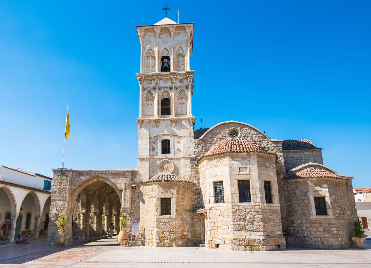 Orthodox church of Saint Lazarus in Larnaca, Cyprus sunny facade with beautiful decorations and blue sky background with soft focus