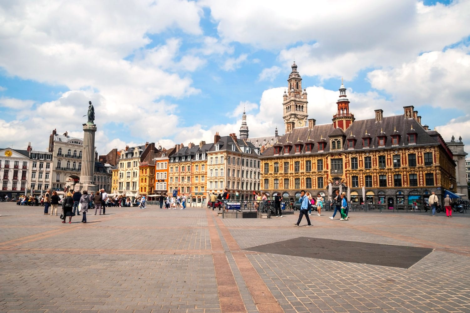 People passing Central town square, La Grand Place in Lille, France