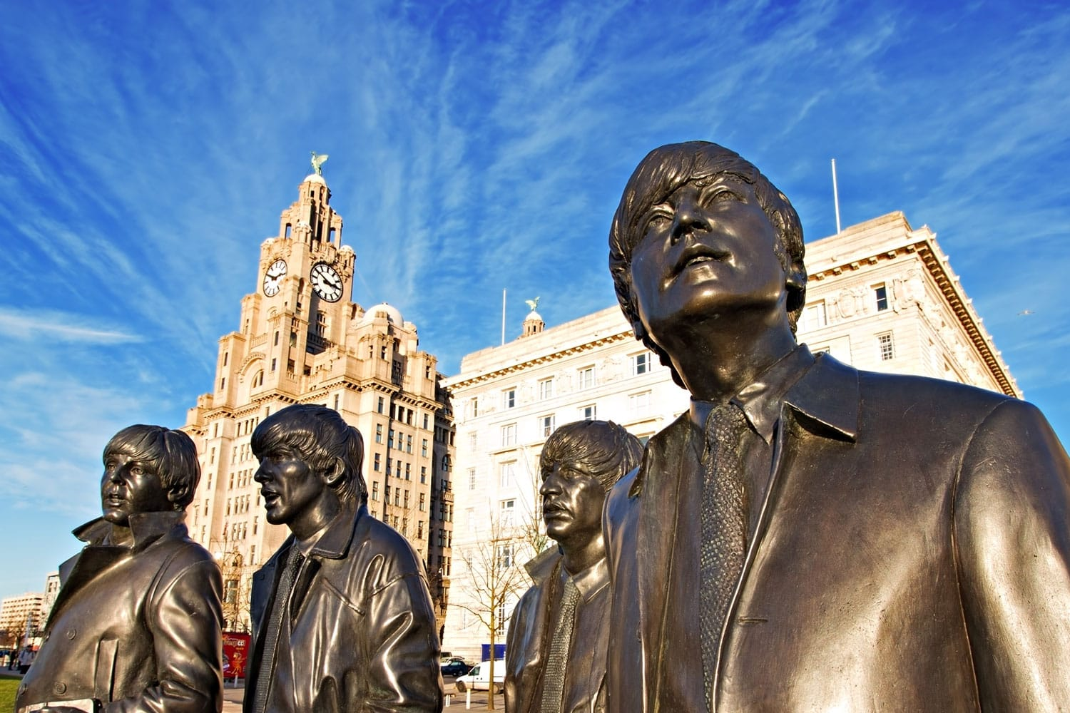 Bronze statue of The Beatles sculpted at the Pier Head in Liverpool