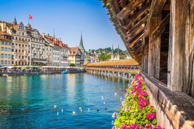 Famous Chapel Bridge in the historic city center of Lucerne, the city's symbol and one of Switzerland's main tourist attractions and views on a sunny day in summer, Canton of Lucerne, Switzerland