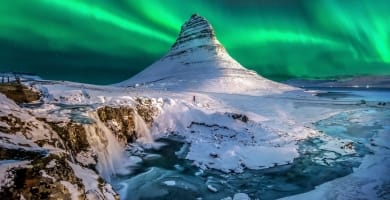 Northern lights appear over Mount Kirkjufell in Iceland.