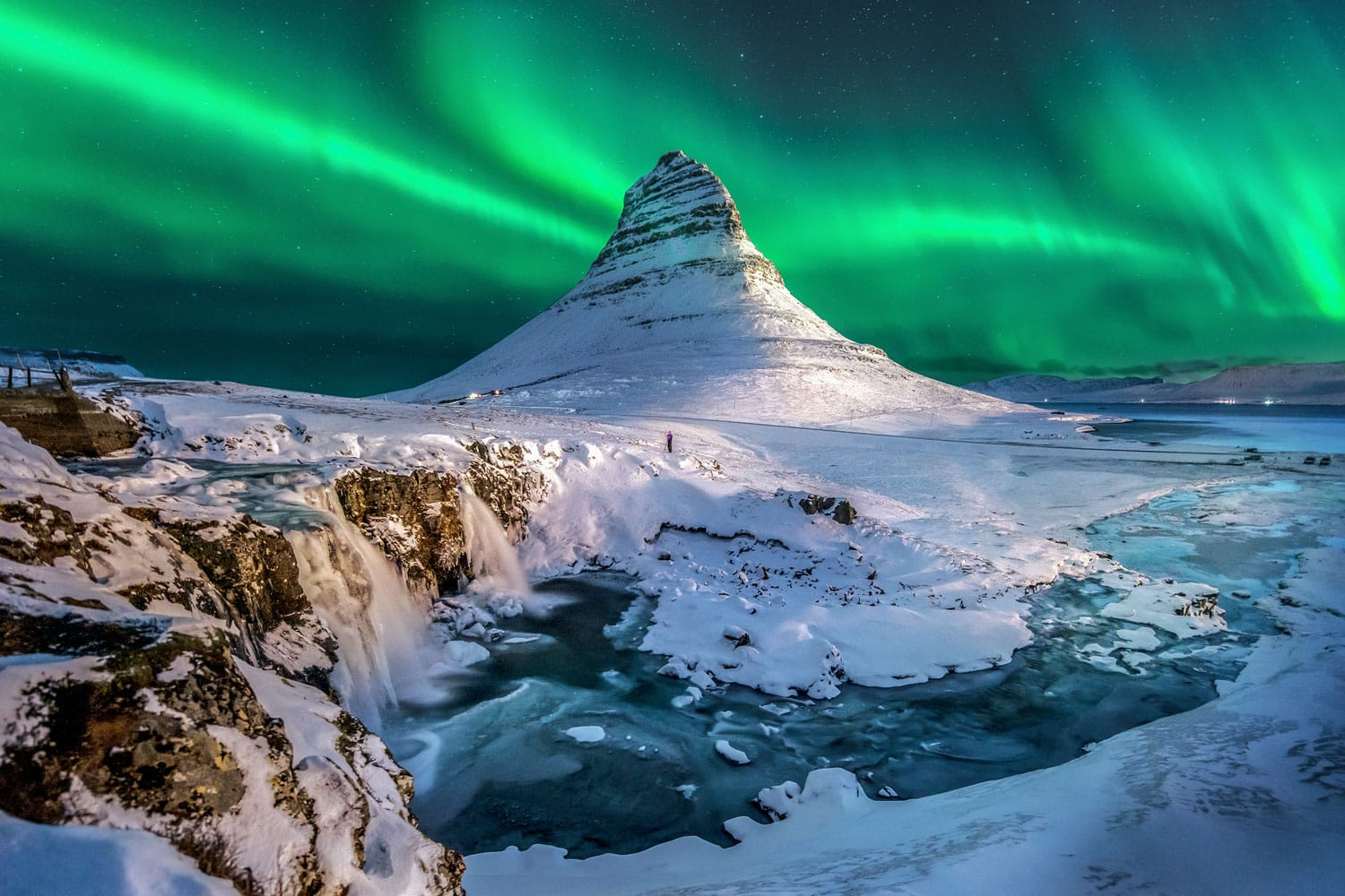 Northern lights appear over Mount Kirkjufell in Iceland.