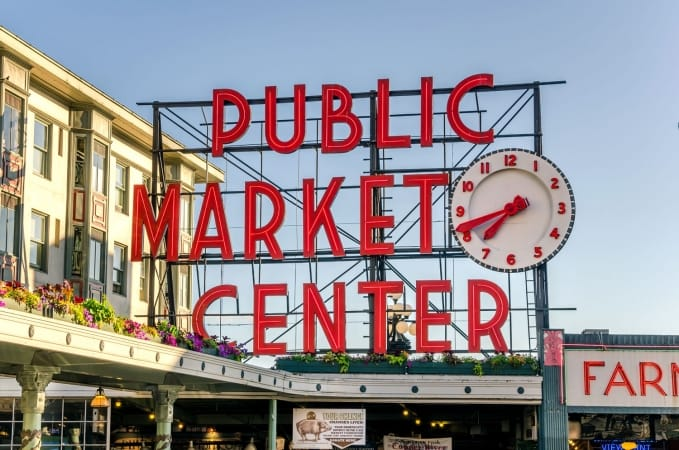 Pike Place Market Neon Sign at sunset in Seattle Washington.