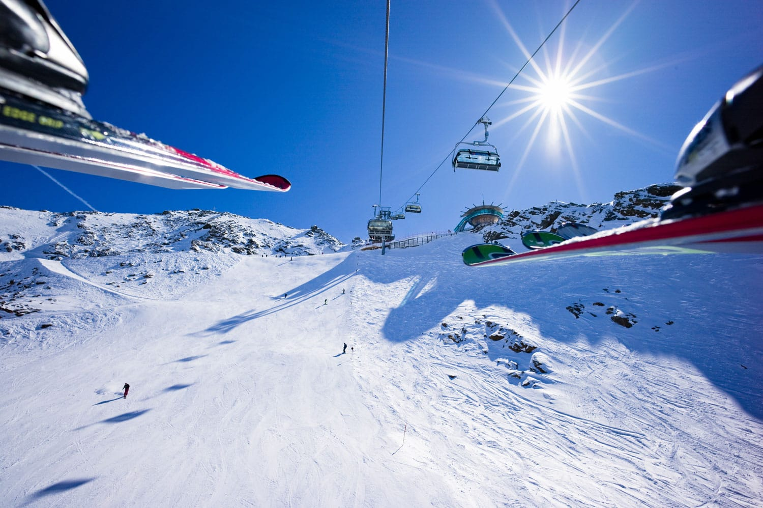 People are riding in chair lift in a ski area. Obergurgl, Austri