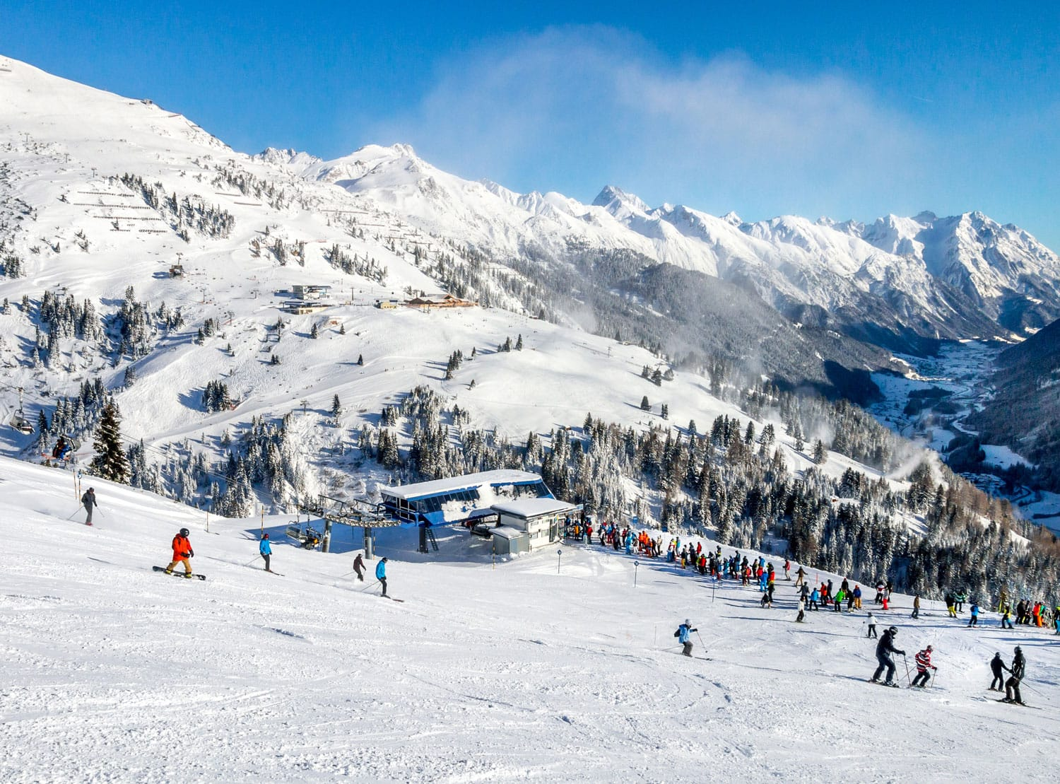 Skiers and snowboarders on the slopes of winter resort St. Anton, Austria.