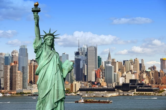 New York City skyline with Statue of Liberty over Hudson River