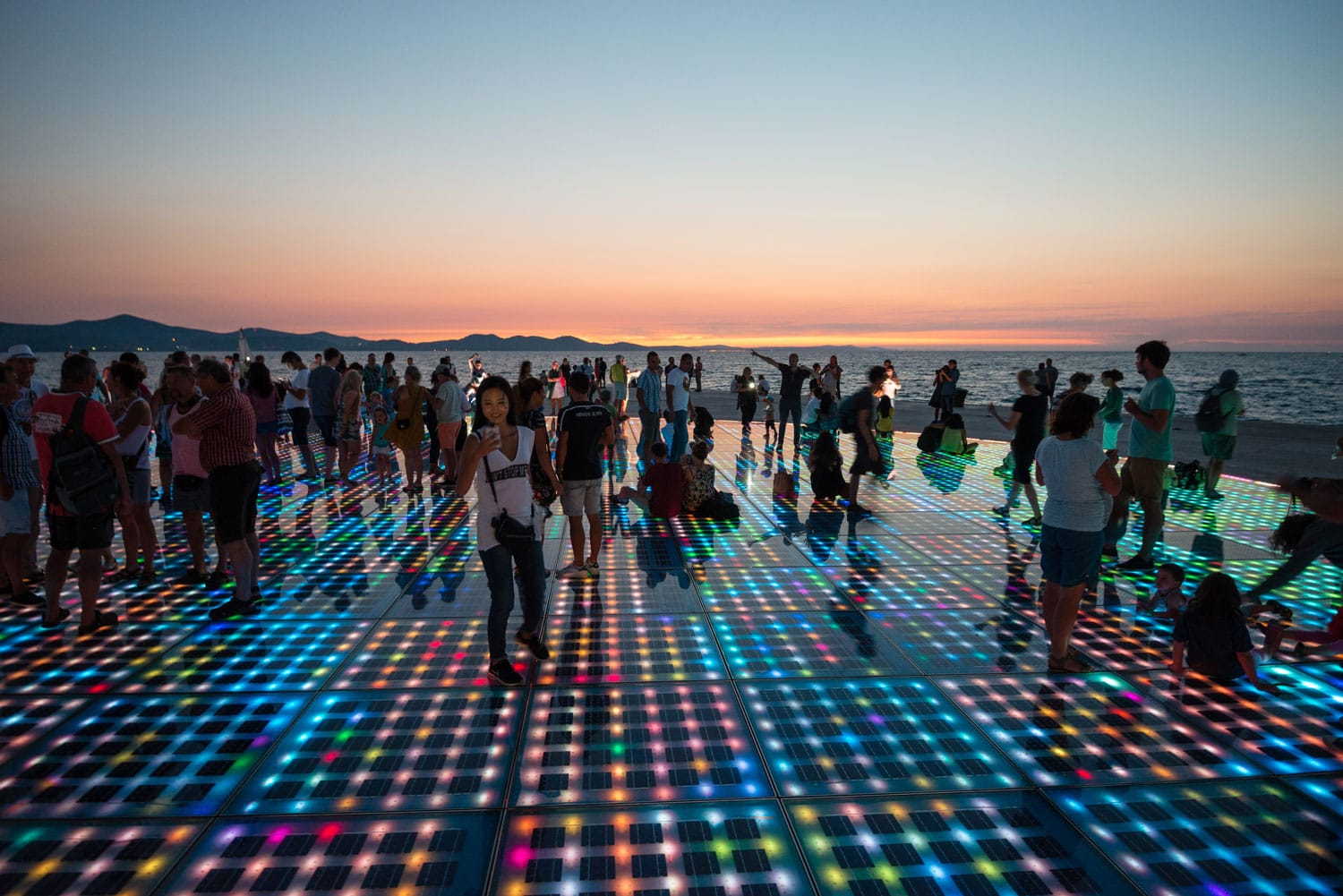 Solar panels lit up at sunset in Zadar, Croatia