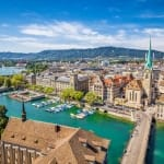 Aerial view of historic Zurich city center with famous Fraumunster Church and river Limmat