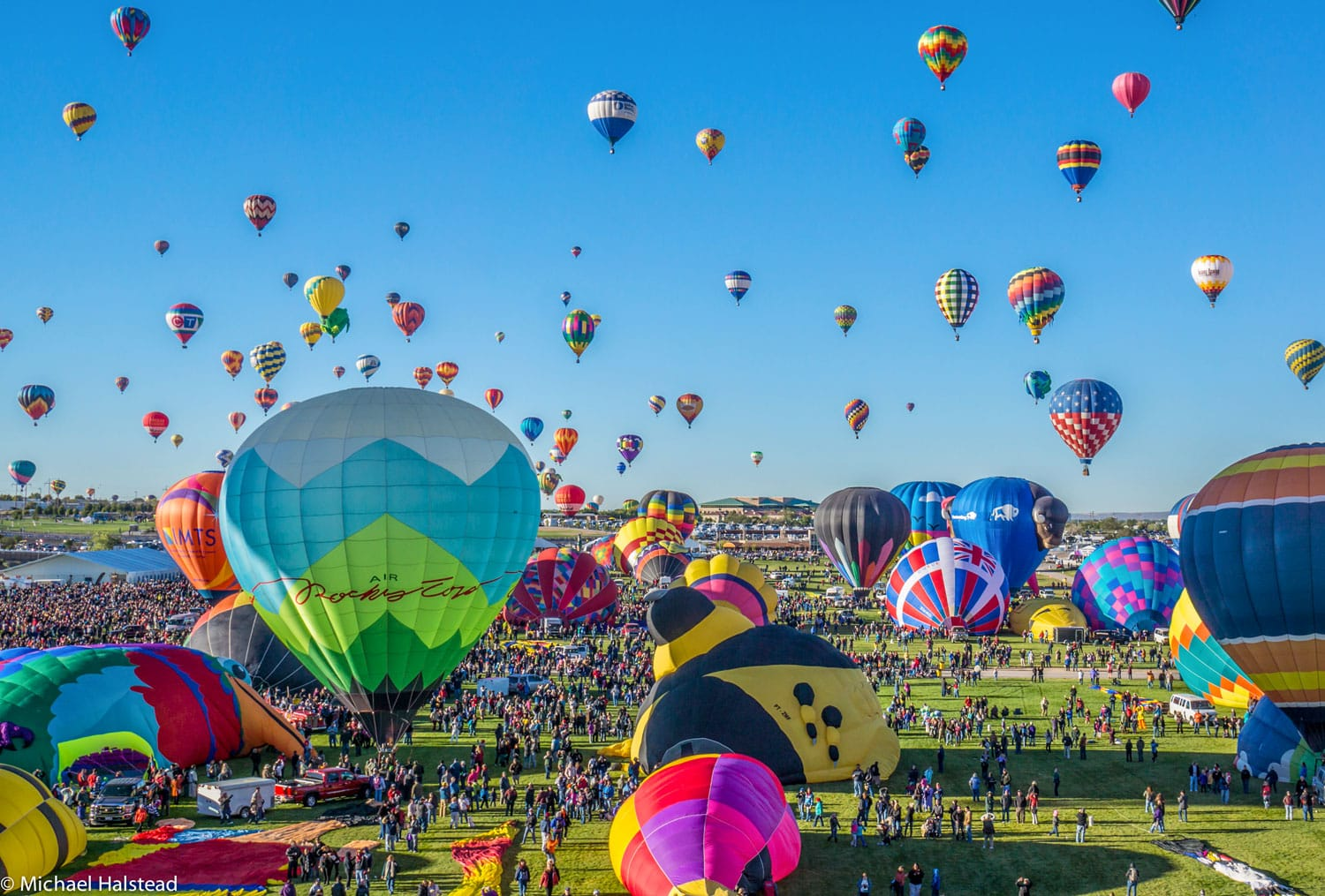Mass ascension begins at the annual Albuquerque Balloon Festival.