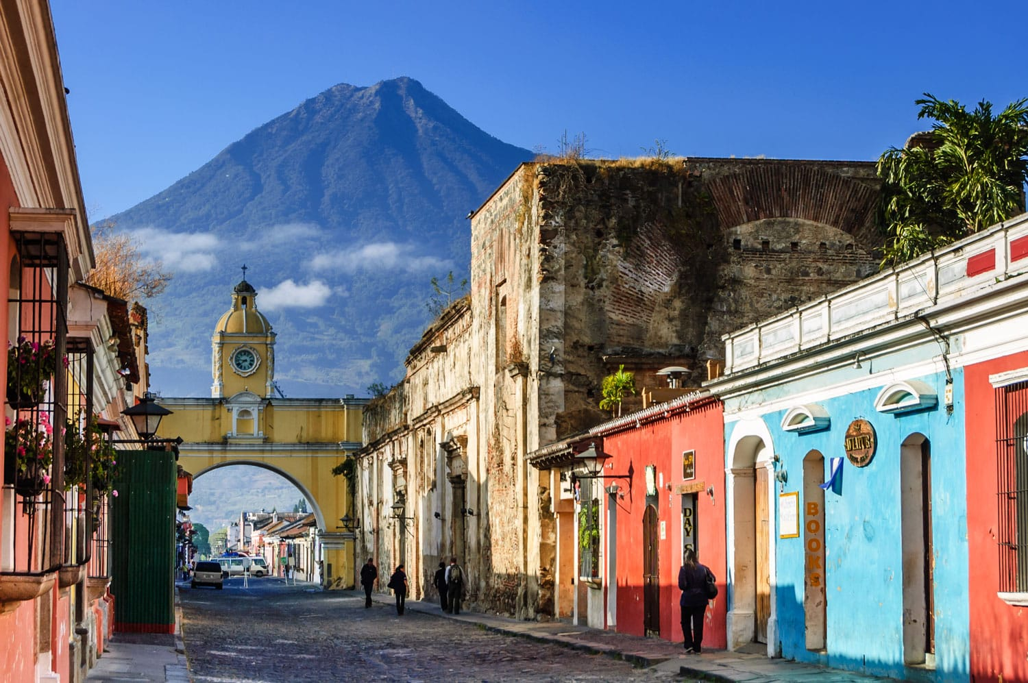 Agua volcano behind Santa Catalina Arch in the colonial town of Antigua, Guatemala