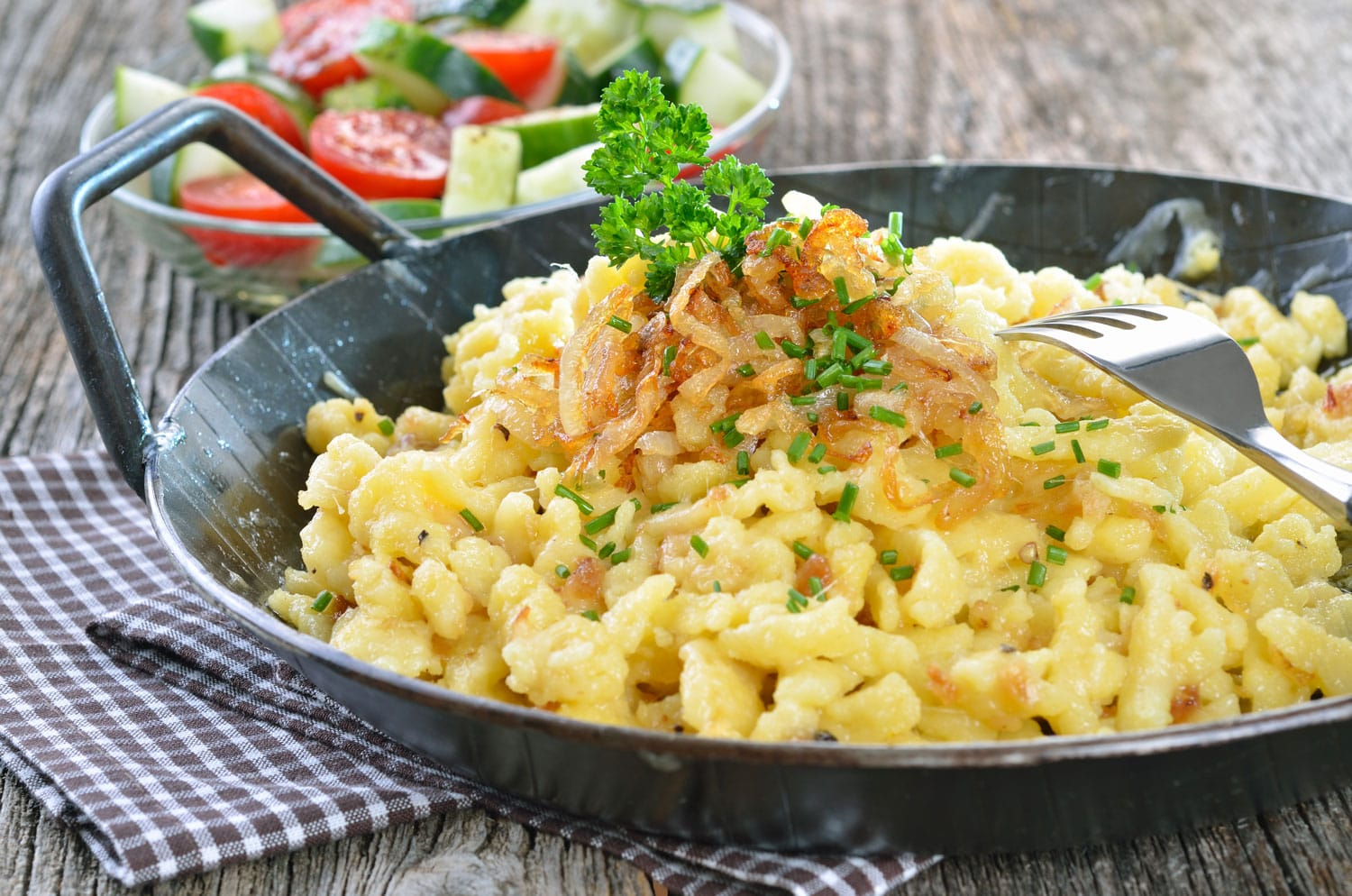 Austrian cheese noodles (spaetzle) in a serving pan