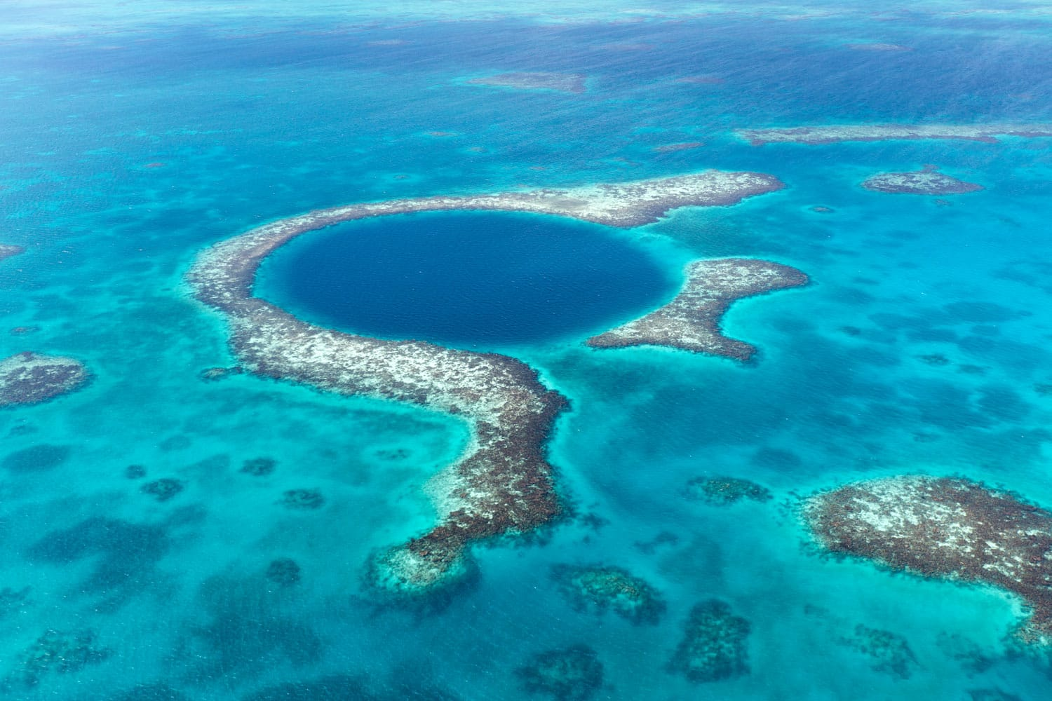 An aerial view of the famous diving spot, Blue Hole off the coast of Belize