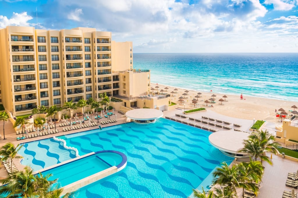 Luxury all-inclusive The Royal Sands resort with beautiful beach and swimming pool.