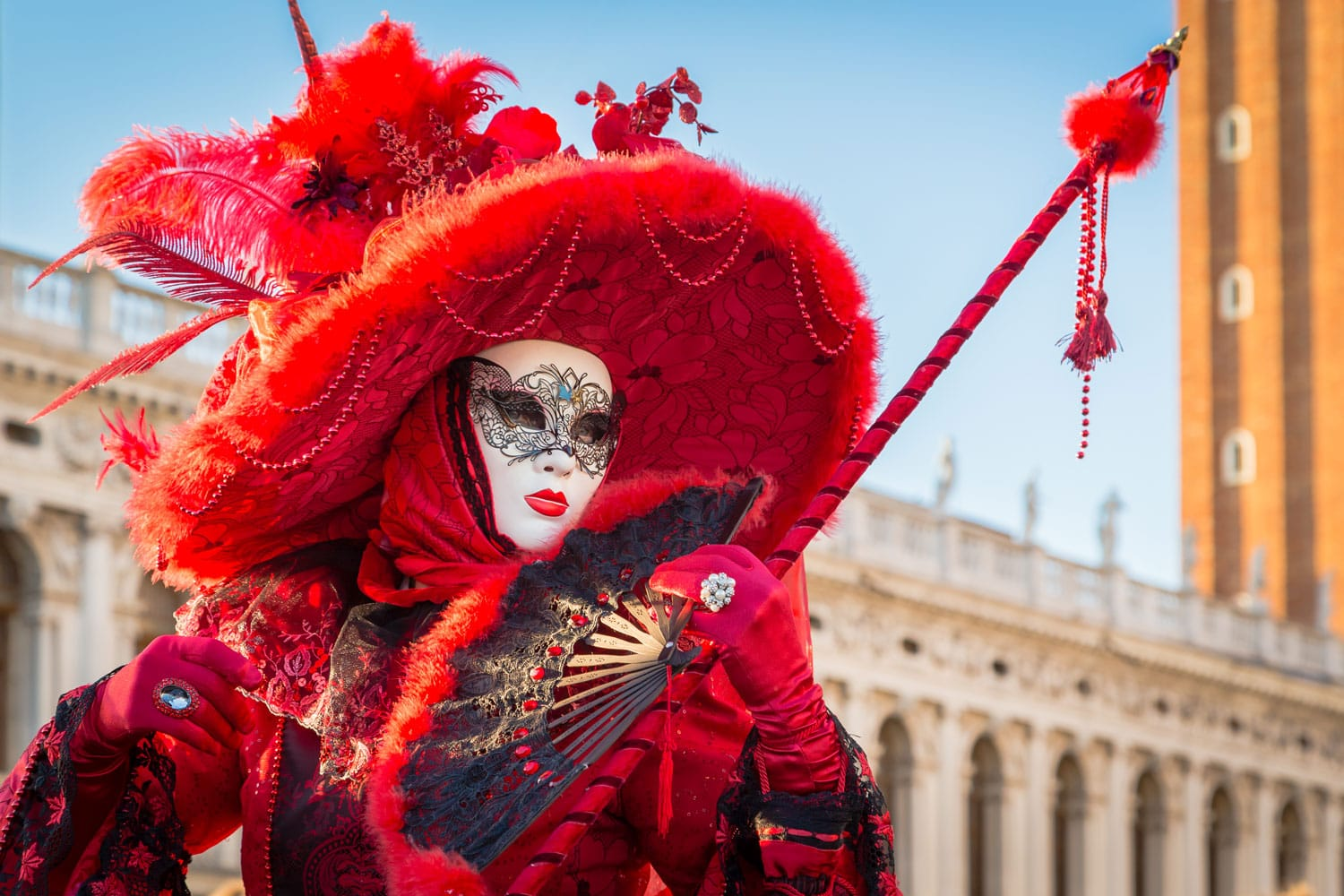 Person in a carnival costume attends the end Carnival of Venice in Venice, Italy