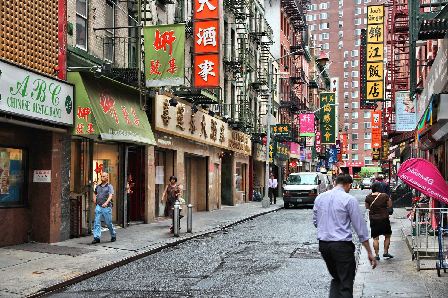 People walking in Chinatown in New York City.