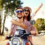 Couple riding a motorbike