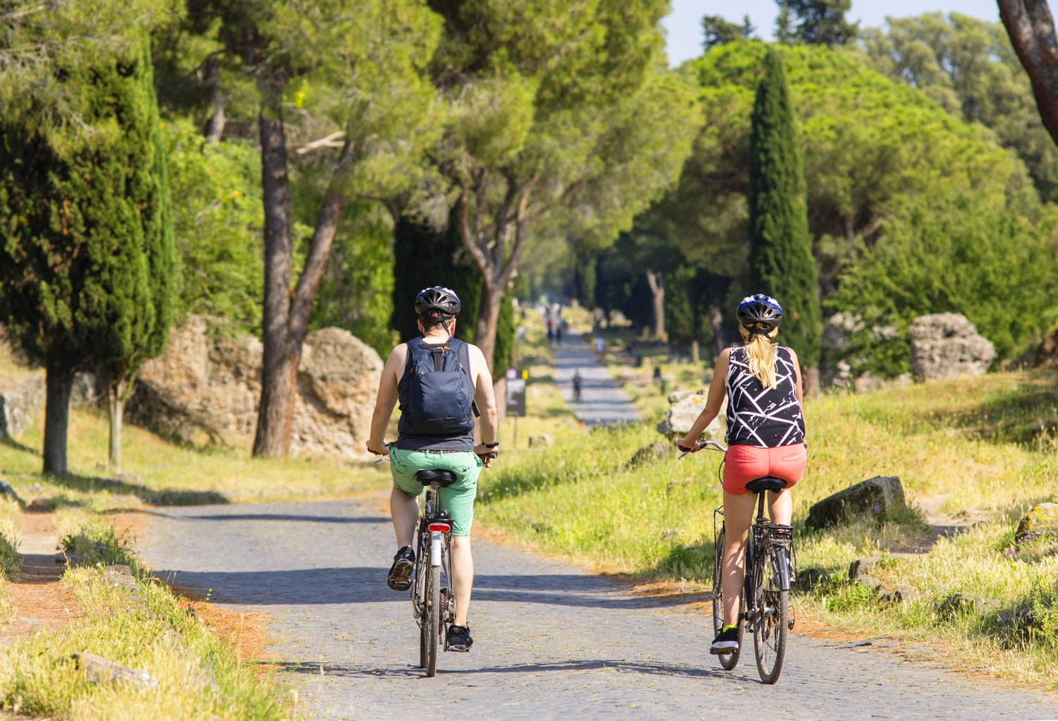 People cycling along Appia Antica, Rome, Italy