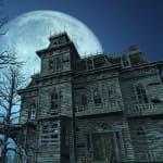 A spooky old haunted house on a moonlit night