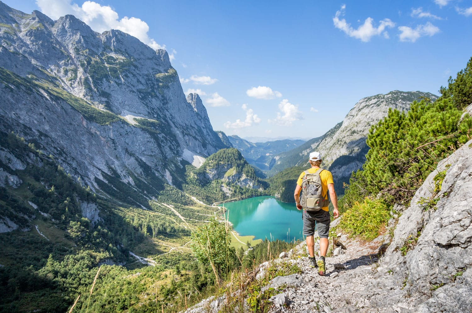 Mountaineer hiking in the mountains at Dachstein, Austria