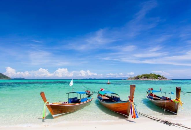 long-tailed boat on Bundhaya beach Koh LIPE Thailand