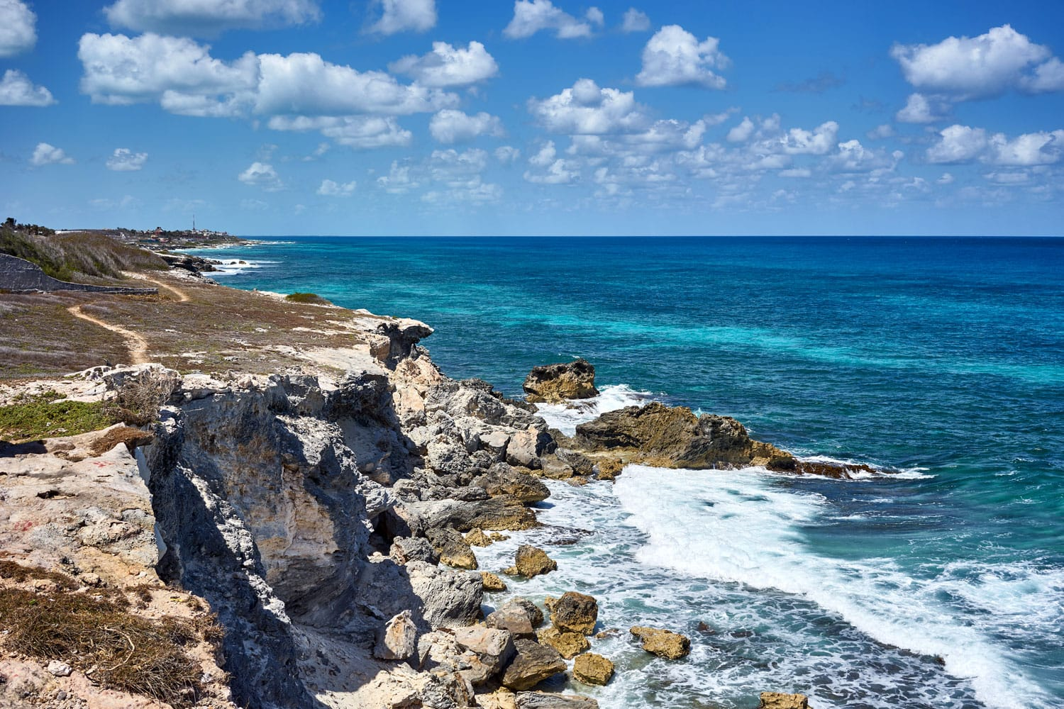 "Rocky coastline of south end ""Punta Sur"" of the mexican Island ""Isla Mujeres"" next to Cancun / Southernmost point of the Island ""Isla Mujeres"" in Mexico / Rocky caribbeans"