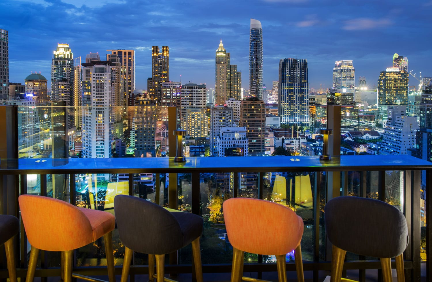 Bangkok city view point from rooftop of building, blue sky and city light, Thailand