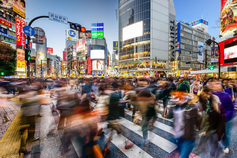 Pedestrians walk at Shibuya Crossing in Tokyo, Japan